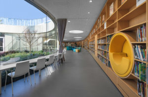 Green Square library books and looking into the outdoor garden, Sydney commercial interior design photographer luke zeme, Architecture Stewart Hollenstein
