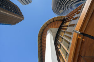 Looking up at the intricate woodwork details of the Wooden Tower EY Building in Sydney, Ernst & Young , Architecture photography by luke zeme, sydney australia